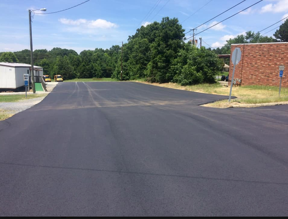 Photo of an asphalt blacktop parking lot that has been resurfaced in High Point, NC